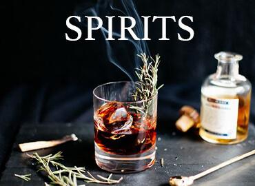 Liquor rhum whisky gin le nez dans le verre caviste en ligne